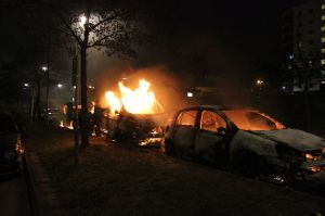 Second_day_of_Husby_riots,_three_burning_cars
